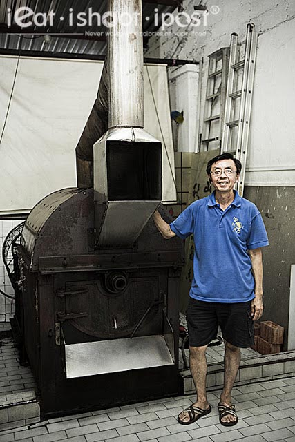 Dominic with a traditional coffee roaster