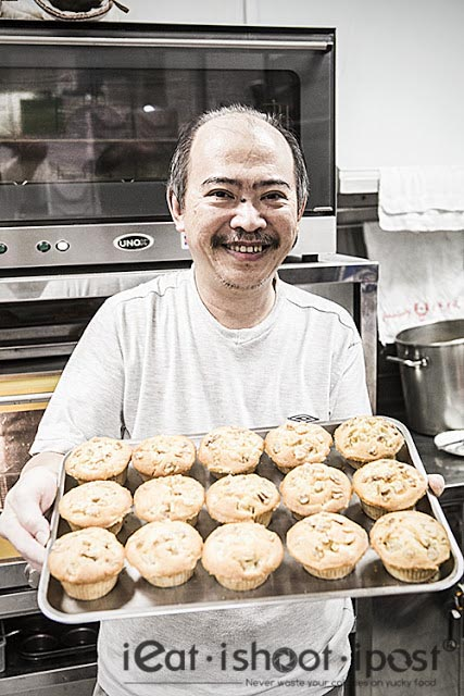 Chef Johnny Ngiam with a tray of freshly baked muffins